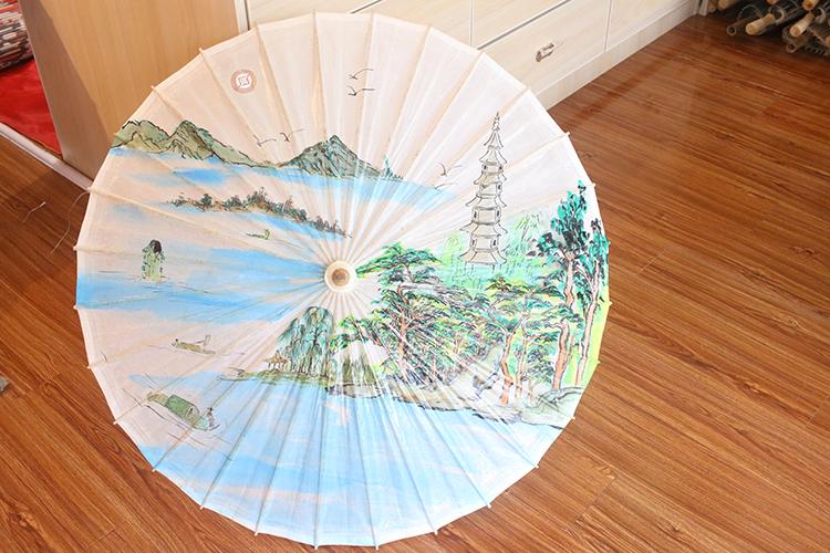 油纸伞保养方法一—淋雨或淋水